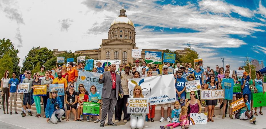 A large group of activists from a climate march at the Georgia capitol building